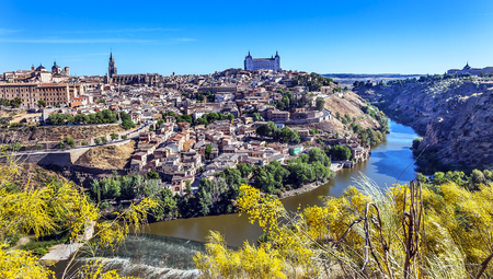 rebuilt: is Alcazar Fortress Churches Cathedral Medieval City Tagus River Toledo Spain.  Toledo Alcazar built in the 1500s, Destroyed in Spanish Civil War and then rebuilt after war. Unesco historical site; Tagus is longest river in Spain. Editorial