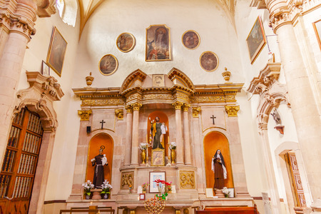 spiritual architecture: Jesus Monk Priest Nun Statues Basilica Templo De La Compania Christmas Poinsettas Guanajuato Mexico.  Built by the Jesuits between 1746 to 1765. Editorial