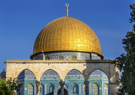 Dome of the Rock Islamic Mosque Temple Mount Jerusalem Israel.  Built in 691 One of most sacred spots in Islam where Prophet Mohamed ascended to heaven on an angel in his night journey.  The Dome covers the rock where Abraham was to sacrifice Issac.  Stock Photo