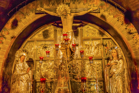 church of the holy sepulchre: Ancient Altarpiece Golgotha Crucifixion Site Church of the Holy Sepulchre Jerusalem Israel.  Church expanded in 1114 to 1170 AD contains Jesus Tomb, resurrection site, and Golgotha