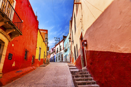 Many Colored Red Yellow Narrow Street Houses of Guanajuato Mexico   Stock Photo