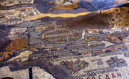 Ancient 6th Century Map Jerusalem Mosaic Saint George's Greek Orthodox Church Madaba Jordan.  Mosaic discovered 1884 and depicts the Holy Land, including Jerusalem, Jordan River and Dead Sea in  6th Century AD.  Map was used to discover Christ's actual ba 報道画像