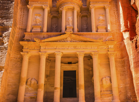 Yellow Golden Treasury Morning Siq Petra Jordan Petra Jordan.  Treasury built by the Nabataens in 100 BC. Yellow Canyon becomes rose red in afternoon.  Inside buildings walls create many abstracts close up.  The rose red can become blood red.  Reds are cr 写真素材