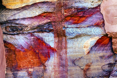 Red Blue Rock Abstract Petra Jordan  Built by the Nabataens in 200 BC to 400 AD.  Rose Red canyon walls create many abstracts close up.  Inside the Tombs, the rose red can become blood red.  Reds are created by magnesium in sandstone.