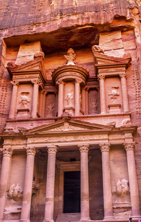 Yellow Treasury in Morning Becomes Rose Red in Afternoon Siq Petra Jordan Petra Jordan.  Treasury built by the Nabataens in 100 BC. Canyon becomes rose red when sun goes.  Inside buildings walls create many abstracts close up.  The rose red can become blo