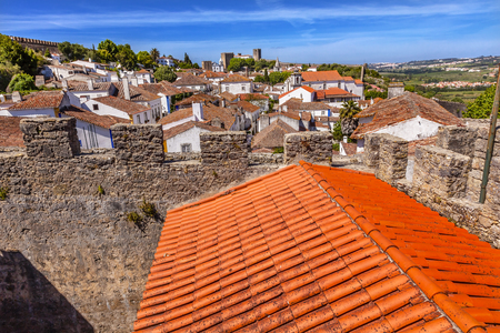 11th century: Castle Wals Turrets Towers Medieval Town Obidos Portugal. Castle and walls built in 11th century after town taken from the Moors. Stock Photo