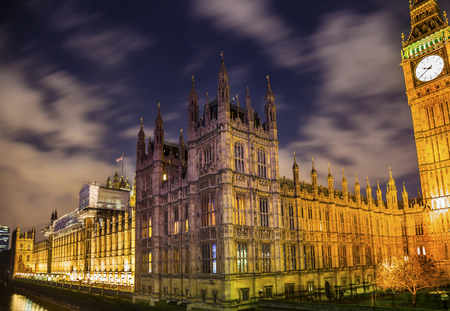 Big Ben Tower Westminster Bridge Thames River Night Houses of Parliament Westminster London England.  Named after the Bell in the Tower. Has kept exact time since 1859. Stock Photo