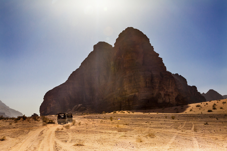 Seven Pillars of Wisdom Rock Formation Jeeps Wadi Rum Valley of the Moon Jordan.  Inhabited by humans since prehistoric times, place where TE Lawrence of Arabia in the early 1900s