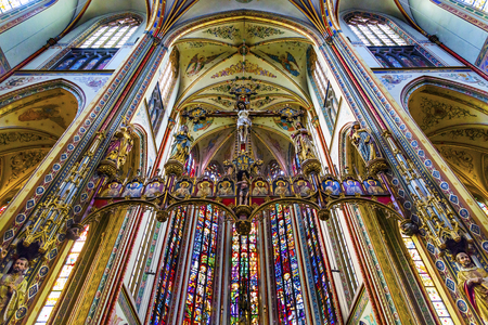 Basilica Christ Crucifix Stained Glass De Krijtberg Church Amsterdam Holland Netherlands. Roman Catholic Church built in 1883, maybe the most beautiful church in Amsterdam. Editorial