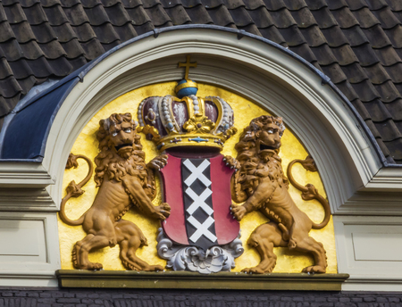 nazis: Amsterdam Coat of Arms Amsterdam Holland Netherlands. On Building Facing the Canal.  The Amsterdam motto in English is Valiant, Steadfast, Compassionate comes from World War 2 where Amsterdamers in 1941 protested against Nazis treatment of the Jews. Editorial