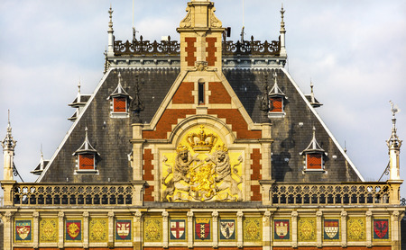 Dutch Coat of Arms Royal Palace Town Hall Amsterdam Holland Netherlands.  Opened up as a train station in 1889.  Town hall in 1655.  162,000 go through the train station today.