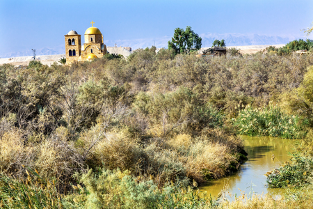 new testament: Jordan River John Baptist Greek Orthodox Church Jesus Baptism Site John Baptist Bethany Beyond Jordan.  Actual baptism site of Jesus.  Jordan River Moved and Ruins are of Byzantine Churches marking spot of baptism.  Rediscovered late 1990s and early 2000. Stock Photo
