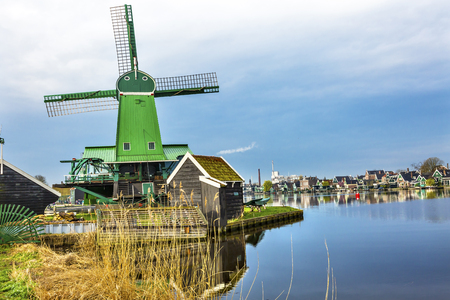 holland windmill: Wooden Windmills Modern Industry Zaanse Schans Old Windmill Village Countryside Holland Netherlands. Working windmills from the 16th to 18th century on the River Zaan.  Windmills powered industries in Holland, such as ship builidng, vegetable oil producti