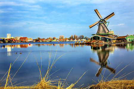 Wooden Windmill River Zaan Zaanse Schans Old Windmill Village Countryside Holland Netherlands. Working windmills from the 16th to 18th century on the River Zaan. Stock Photo