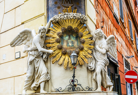 commemorate: Madonna del Archetto Angels Statues Street Piazza de Trevi Fountain Rome Italy.  Small church created in 1800s to commemorate madonna picture with moving eyes