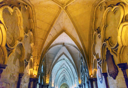 Cloisters Interior Arches 13th Century Westminster Abbey Church London England.  Westminister Abbey has been the burial place of Britains monarchs since the 11th century and is the setting for many coronations and weddings.