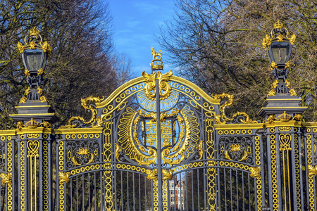 webb: Golden Canada Maroto Gate Buckingham Palace London England.  Created in 1901 as a memorial to Queen Victoria, who died in 1901 and is the entrance to Green Park.  The Gate leads to Trafalgar Square. Designed by Aston Webb, with Symbols of Canadian provinc