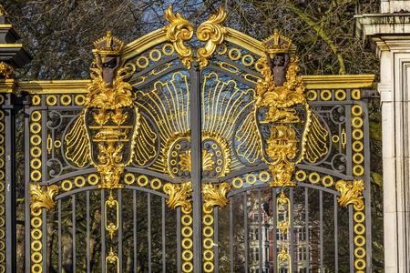 Golden Canada Maroto Gate Buckingham Palace London England.  Created in 1901 as a memorial to Queen Victoria, who died in 1901 and is the entrance to Green Park.  The Gate leads to Trafalgar Square. Designed by Aston Webb, with Symbols of Canadian provinc