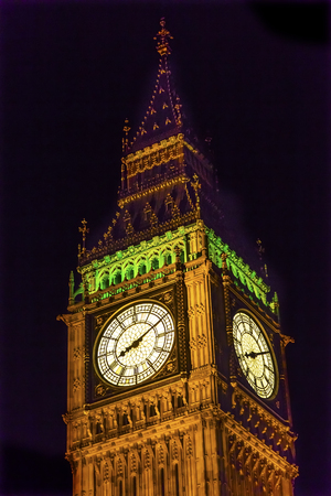 Big Ben Tower Houses of Parliament Night Westminster London England.  Named after the Bell in the Tower. Has kept exact time since 1859.