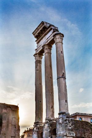 Temple of Vespasian and Titus Corinthian Columns Roman Forum Rome Italy.  Temple created in 79 AD by Emperor Titus, finished by Emperor Vespacian