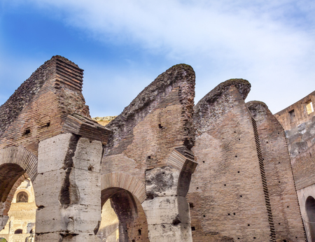 Arches Bricks Concrete Building Materials Construction Colosseum Rome Italy.  Built by Emperors Vespasian and Titus in 80 AD with sand and concrete largest amphitheater every built.  Symbol Imperial Rome. Could hold 50 to 80,000 spectators.