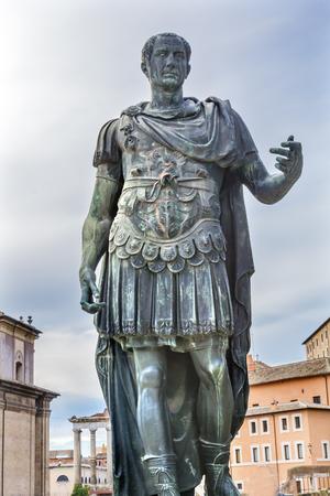 Julius Caesar Bronze Statue Roman Forum Rome Italy.  Julius Caesar rebuilt Roman Forum in 46 BC  Copy of ancient statue of Julius Caesar.