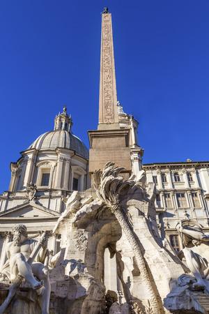 Bernini Fontana Quattro dei Fiumi Fountain of Four Rivers Saint Agnese In Agone Church Obelisk Piazza Navona Rome Italy.  Piazza site of Roman racetrack created in 1600s.   Bernini created fountain in 1651.  Saint Agnese Church created in 304 AD later reb