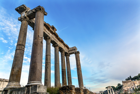 Temple of Saturn Corinthian Columns Roman Forum Rome Italy.  Temple created in 42 BC to celebrate past mythical god king of Rome Archivio Fotografico