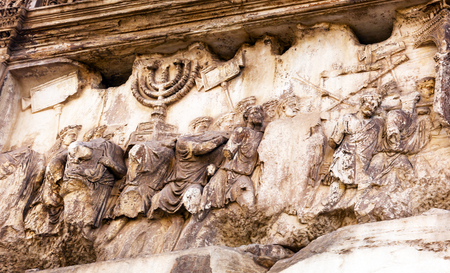 Titus Arch Roman Loot Menorah Temple Jerusalem Forum Rome Italy.  Stone arch was erected in 81 AD in honor of Emperor Vespasian and his son Titus for conqueiring Jerusalem and destroying the Jewish temple in 70 AD.  The Colosseum and the Arch were funded