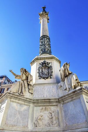 Virgin Mary Statue Immaculate Conception Column Colonna dell Immocolata Rome Italy.  1854 Pope declares Virgin Mary without sin.  Column created 1857 and December 8th Pope puts flower wreath on statue start of Christmas.