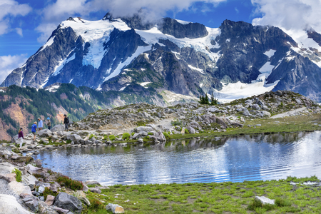 Hikers Mount Shuksan Pool Reflection Summer Artist Point Mount Baker Highway Pacific Northwest Washington State Snow Mountain Grass Trees Stock Photo