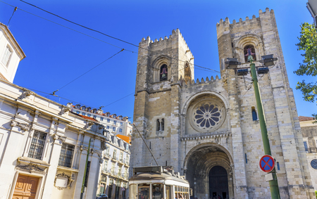 The Se Sedes Episcopalis Cathedral Trolley Lines Lisbon Portugal.  The Cathedral was built in 1155 after Lisbon was taken from the Moors. Removated in 1755 aftr the earthquake.