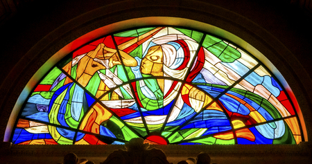 Mary Stained Glass Basilica of Lady of Rosary Fatima Portugal. Church created on site where three Portuguese Shepherd children saw Virgin Mary of the Rosary.  Basilica created in 1953.  Редакционное