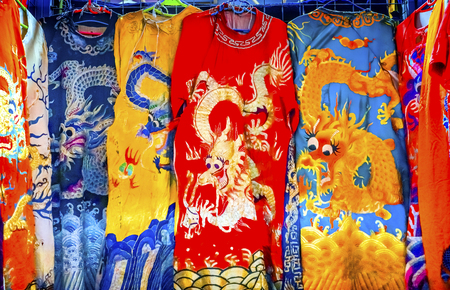 Blue Red Yellow Chinese Dragon Replica Silk Garments Robes Panjuan Flea Market  Decorations Beijing China.  Panjuan Flea Curio market has many fakes, replicas and copies of older Chinese products, many ancient.