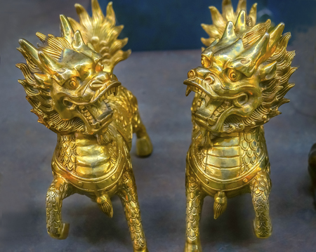 Chinese Replica Bronze Dragons in Panjuan Flea Market, Beijing, China. Panjuan Flea Curio market has many fakes, replicas and copies of older Chinese products, many ancient.