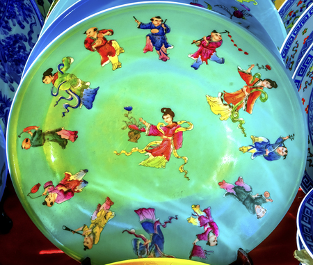 Old Colorful Chinese Ladies Figures Qinq Dynasty  Ceramic Plate  Panjuan Flea Market  Beijing China. Panjuan Flea Curio market has many fakes, replicas and copies of older Chinese products, many ancient. Banco de Imagens