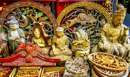 Chinese Replica Wooden Buddhas for Decorations in  Panjuan Flea Market, Beijing China. Panjuan Flea Curio market has many fakes, replicas and copies of older Chinese products, many ancient.