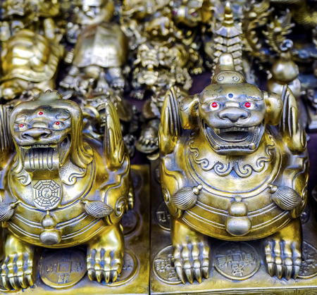 Chinese Replica Bronze Dragons Panjuan Flea Market  Decorations Beijing China.  Panjuan Flea Curio market has many fakes, replicas and copies of older Chinese products, many ancient.
