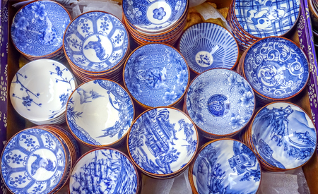 Old Chinese Design Blue White Ceramic Plates  Panjuan Flea Market  Beijing China. Panjuan Flea Curio market has many fakes, replicas and copies of older Chinese products, many ancient. Banco de Imagens