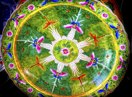 Old Chinese Design Flower Design Ceramic Plate  Panjuan Flea Market  Beijing China. Panjuan Flea Curio market has many fakes, replicas and copies of older Chinese products, many ancient.