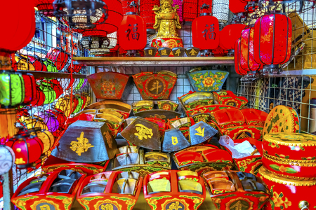 Colorful Blue Red Green Chinese Paper Lanterns Drums Boxes Panjuan Flea Market  Beijing China. Panjuan Flea Curio market has many fakes, replicas and copies of older Chinese products, many ancient. One Chinese character says luck. Banco de Imagens