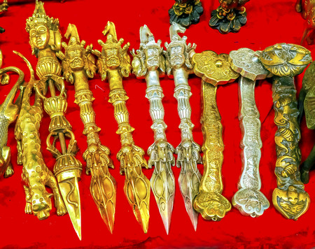 Chinese Replica Buddhist Knives Decorations Panjuan Flea Market  Decorations Beijing China.  Panjuan Flea Curio market has many fakes, replicas and copies of older Chinese products, many ancient.