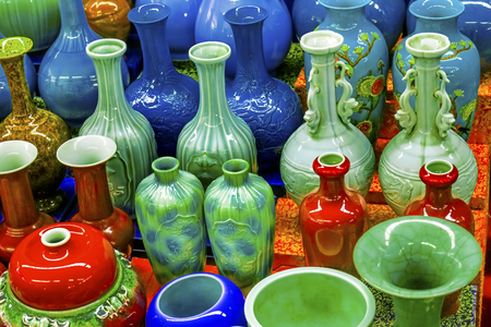 Old Chinese Design Blue Green Red Ceramic Vases  Panjuan Flea Market  Beijing China. Panjuan Flea Curio market has many fakes, replicas and copies of older Chinese products, many ancient. Banco de Imagens