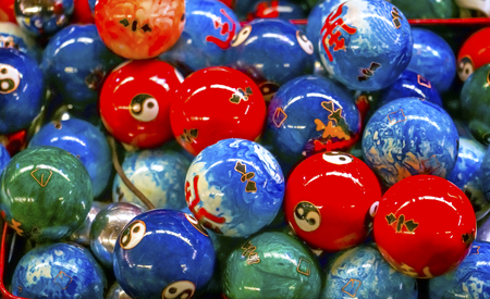 Chinese Replica Metal Buddhist Prayer Balls Decorations Panjuan Flea Market  Decorations Beijing China. Symbols on ball are Ying Yang, famous Buddhist saying on opposites. Panjuan Flea Curio market has many fakes, replicas and copies of older Chinese products, many ancient. Banco de Imagens