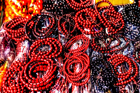 Brown Black Chinese Buddhist Prayer Beads  Panjuan Flea Market  Beijing China. Panjuan Flea Curio market has many fakes, replicas and copies of older Chinese products, many ancient.
