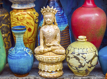 Old Chinese Design Blue White Ceramic Buddha Pots Panjuan Flea Market  Beijing China. Panjuan Flea Curio market has many fakes, replicas and copies of older Chinese products, many ancient.