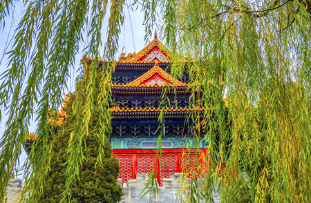 Arrow Watch Tower Willow Tree Autumn Gugong Forbidden City  Palace Wall Beijing China. Emperors Palace Built in the 1600s in the Ming Dynasty