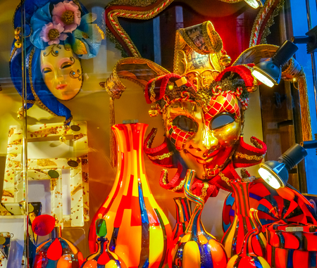 Venetian Masks Colorful Glass Venice Italy Masks used since the 1200s for Carnival, which were celebrated just before Lent.  In ancient times, Masks allowed the Venetians to do what was illegal, such as gambling. Editorial