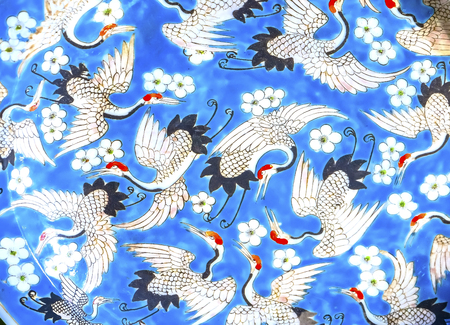 Old Chinese Design Blue White Red Cranes Ceramic Plate  Panjuan Flea Market  Beijing China. Panjuan Flea Curio market has many fakes, replicas and copies of older Chinese products, many ancient. Banco de Imagens
