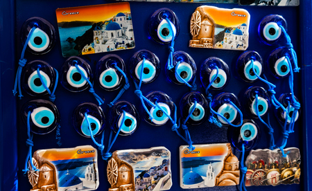 Greek Ceramic Designs Evil Eye Magnets, Parthenon Athens Greece. Evil eye is a curse in the form of a stare.  Evil eye symbols are a defense against curses Stock Photo